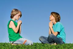 Prayer group children praying Stock Images