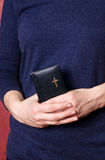 Prayer in hands. Woman holds prayer in her hands Royalty Free Stock Images