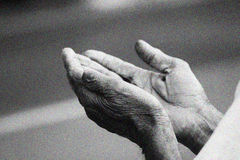 Prayer Hands. Coming together for peace, faith stock photo
