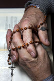 Prayer hands with rosary study bible Royalty Free Stock Photography