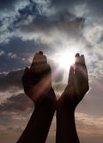 Prayer with hands to sun. Sunbeam Royalty Free Stock Images
