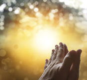 Prayer. Hands together praying in bright sky Stock Photos