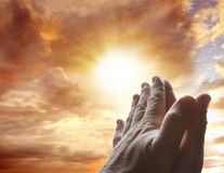 Prayer. Hands together praying in bright sky Royalty Free Stock Images