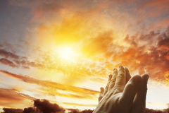 Prayer. Hands together praying in bright sky Royalty Free Stock Photo