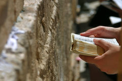 Prayer holds Torah during prayer at Western Wall. Royalty Free Stock Photos