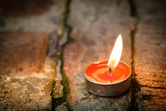 Prayer and hope concept.Candle flame light at night with abstrac. T circular bokeh background Royalty Free Stock Images