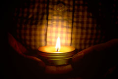 Prayer and hope concept of candle light in hands.  Stock Photo