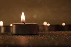 Prayer and hope concept. Retro candle light with lighting effect Royalty Free Stock Photos