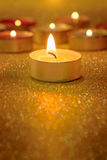 Prayer and hope concept. Retro candle light with lighting effect. And glitter abstract background with bokeh defocused lights Stock Photo