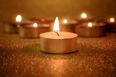 Prayer and hope concept. Retro candle light with lighting effect Stock Images