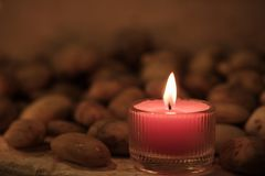 Prayer and hope concept. Retro pink candle light and old stone w stock photo