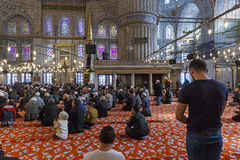 Prayer in the Mosque of Sultan Ahmed Stock Photo