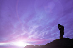 Prayer. On mountain top - silhouette royalty free stock image
