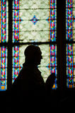Prayer in Notre Dame de Paris Royalty Free Stock Photo