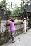 Prayer Offerings at Tirtha Empul Temple, Bali. Image of devotees preparing prayer offerings at Tirtha Empul Temple, Bali, Indonesia Royalty Free Stock Photo