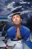 Prayer is an office worker Royalty Free Stock Image