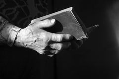 Prayer of old woman with the book Royalty Free Stock Image