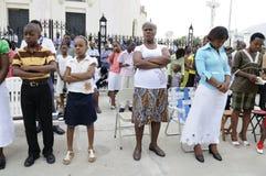 Prayer outside a church. Royalty Free Stock Image