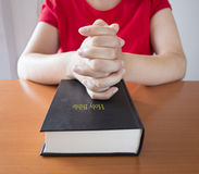 Prayer over a holy bible closed Stock Photography