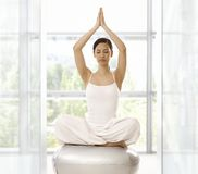 Prayer position. Young woman sitting in prayer position, practicing yoga indoors Royalty Free Stock Photo