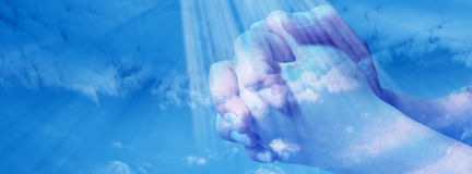 Prayer. S hands in the blue sky -facebook cover stock image