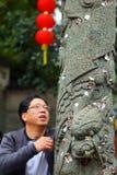 Prayer put money on dragon totem wish good luck Royalty Free Stock Photo