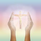 Prayer raised hands for glowing Jesus Christ. On the Cross stock image