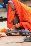A prayer reciting a holy book at Kumbeshwar Temple, Nepal Stock Images