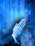 Prayer Religion Technology Computer. A conceptual image of hands in prayer with a computer circuit board background Royalty Free Stock Photo