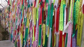 Prayer ribbons attached to a barbed wire fence. Near the border between North and South Korea, I m told they have messages of hope, dreams and wishes for Stock Images