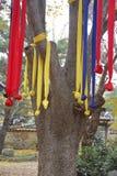 Prayer ribbons in autumn color at Namsangol traditional folk village, Seoul, South Korea- NOVEMBER 2013 Royalty Free Stock Photography
