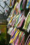 Prayer ribbons, DMZ, South Korea. Prayer ribbons attached to barbed wire fence near the border between North and South Korea stock image