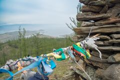Prayer ribbons on top of the hillock dedicated to a local Tutelary deity. Siberia, Russia stock image