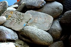 Prayer Rocks. Prayers carved on rocks outside a Buddhist monastery Royalty Free Stock Photography