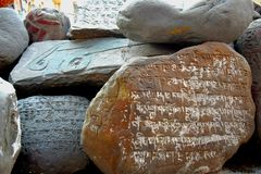 Prayer Rocks. Prayers carved on rocks outside a Buddhist monastery Stock Images