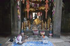 Prayer at ruins of Angkor Wat Royalty Free Stock Photo