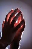 Prayer's hands Stock Photos