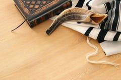 Prayer Shawl - Tallit, Prayer book and Shofar horn jewish religious symbols. Rosh hashanah jewish New Year holiday, Shabbat an. D Yom kippur concept stock photo