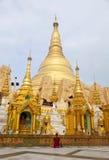 Prayer at Shwedagon Paya. A woman sits in prayer before Shwedagon Paya in Yangon, Myanmar Royalty Free Stock Photos