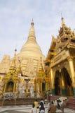 Prayer Before Shwedgaon. Burmese people kneel before Shwedagon Paya in prayer in Yangon, Myanmar Royalty Free Stock Image