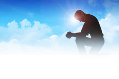 Prayer. Silhouette illustration of a man praying among the clouds Royalty Free Stock Photos
