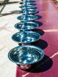 Prayer silver bowls Stock Photo