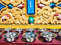Prayer silver bowls on the altar, Dharmshala Royalty Free Stock Photos