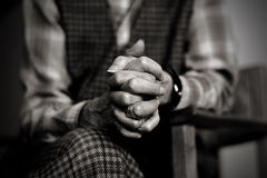 Prayer of sorrow. An old widow is praying while mourning her late husband Royalty Free Stock Photo