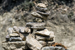 Prayer stone stack pyramid symbolizing zen, harmony and balance is commonly found around bhutan monastery Royalty Free Stock Images