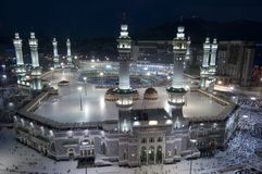 Prayer and Tawaf of Muslims Around AlKaaba in Mecca, Saudi Arabia. Aerial Top View stock images