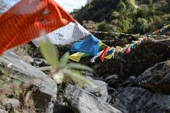Prayer tibetian flag. Closeup shot of tibetian prayer flags in the mountais at windy day royalty free stock photos