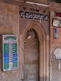 Prayer times at the mosque. AHMEDABAD, INDIA - OCTOBER 29, 2016: Prayer times, known as Salah, listed in the sixteenth century Siddi Sayed mosque in the old city Stock Photo