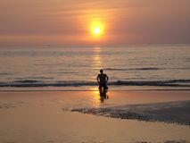 Prayer to the Sun. Sunset in south asia Royalty Free Stock Photos