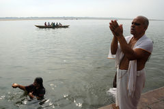 Prayer To The Sun God. People doing rituals at the Ganges river in Varanasi-India Stock Images